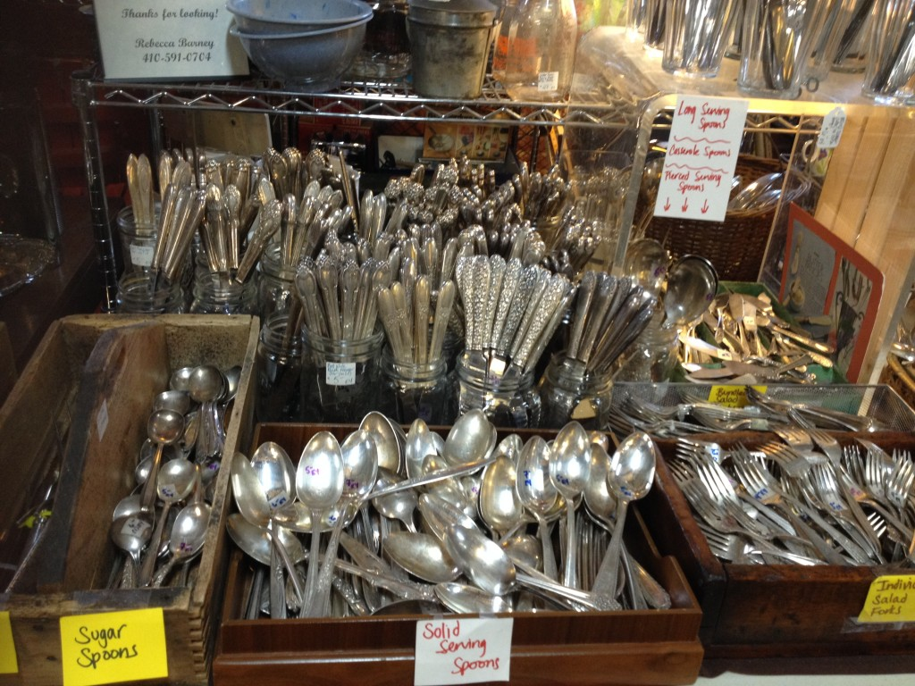 Barney's Antiques' (E4) amazing selection of silverplate flatware.
